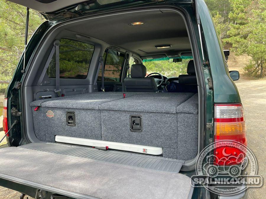 Тойота Ленд Крузер 100 - автомобильный спальник с интегрированным раскладным столом